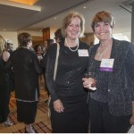 2015 WJA Public Official honoree Sue Chrisman stands with friend, fellow judge and WJA alem Nancy Rahmeyer, at the reception for the 2015 Women's Justice Awards.