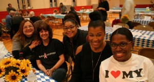 Donna Walter, Trish Farriss, Ashley Yount, Andrea Stanley and Erica Reed participate with the Brown & Crouppen table.
