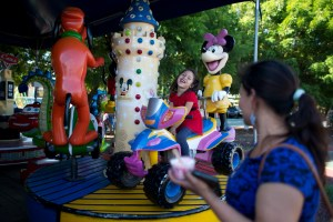 Five-year-old Alexa laughs with her mother, Araceli Ramos, while riding a merry-go-round at a park in San Miguel, El Salvador. Araceli Ramos was deported from the U.S. without Alexa, and was told she would never see her daughter again. AP Photo by Rebecca Blackwell