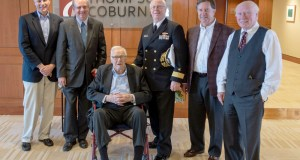 Thompson Coburn retired partner Joe Logan, center, celebrates his 98th birthday with, from left, firm Chairman Tom Minogue, partner Mark Sableman, retired Rear Admiral Lee J. Metcalf, partner Tom Corbett and senior counsel Michael O'Keefe. Photo by Petty Officer Chris Williamson of the St. Louis Navy Recruiting Command, courtesy of Thompson Coburn