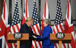 """Britain's Prime Minister Theresa May and US President Donald Trump take part in a joint press conference at the Foreign & Commonwealth Office, in London. Moving from pageantry to policy during his state visit to Britain, President Donald Trump on Tuesday urged embattled Prime Minister Theresa May to """"stick around"""" to complete a U.S.-U.K. trade deal, adding to this recent chapter of uncertainty in the allies' storied relationship. Photo by Stefan Rousseau via pool"""