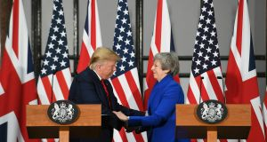 "Britain's Prime Minister Theresa May and US President Donald Trump take part in a joint press conference at the Foreign & Commonwealth Office, in London. Moving from pageantry to policy during his state visit to Britain, President Donald Trump on Tuesday urged embattled Prime Minister Theresa May to ""stick around"" to complete a U.S.-U.K. trade deal, adding to this recent chapter of uncertainty in the allies' storied relationship. Photo by Stefan Rousseau via pool"