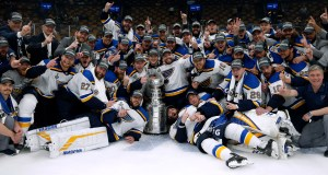 The St. Louis Blues celebrate with the Stanley Cup after they defeated the Boston Bruins in Game 7 of the NHL Stanley Cup Final on Wednesday. AP Photo by Michael Dwyer