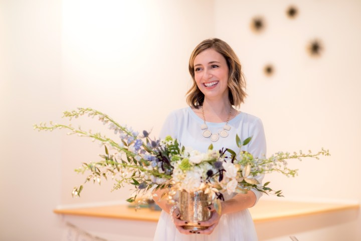 photo of Mollyann with floral arrangement
