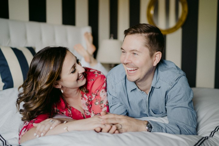 photo of the couple laughing on the bed