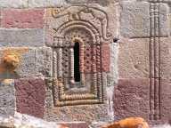Dinosaur window decorations on the bell tower of sameba