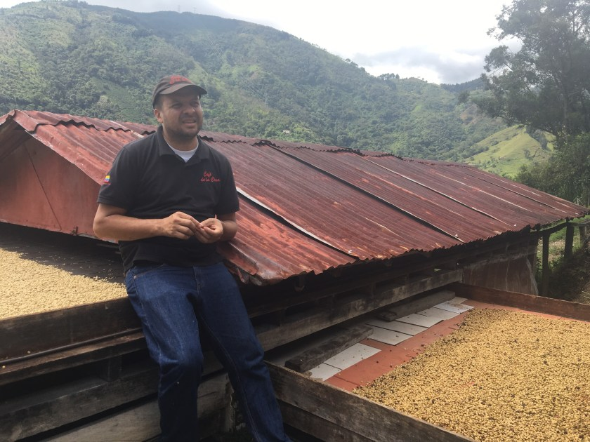 A coffee farmer telling about different about wash technique