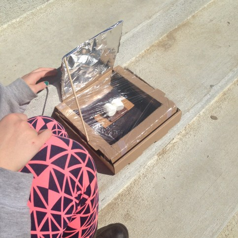 cooking smores in solar-powered ovens at the library | wrapped up in books