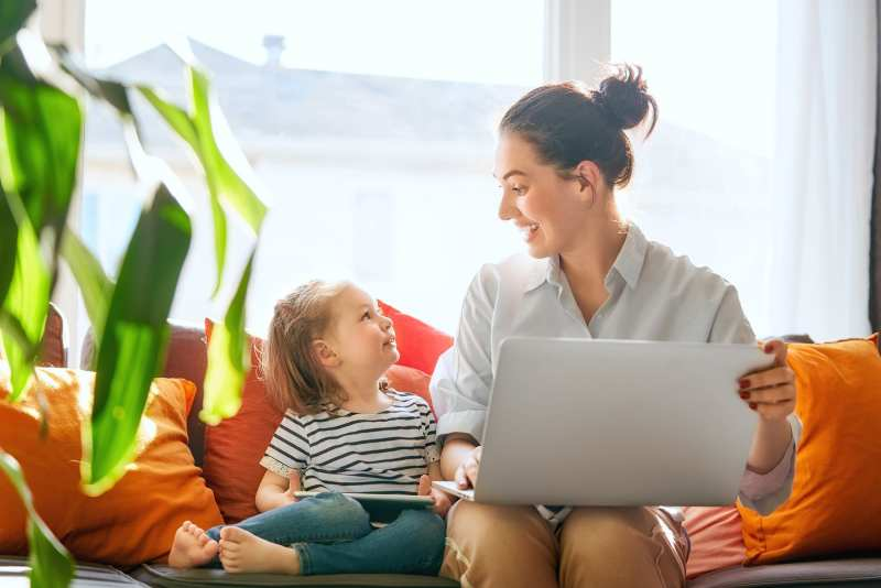 mom and child with laptop