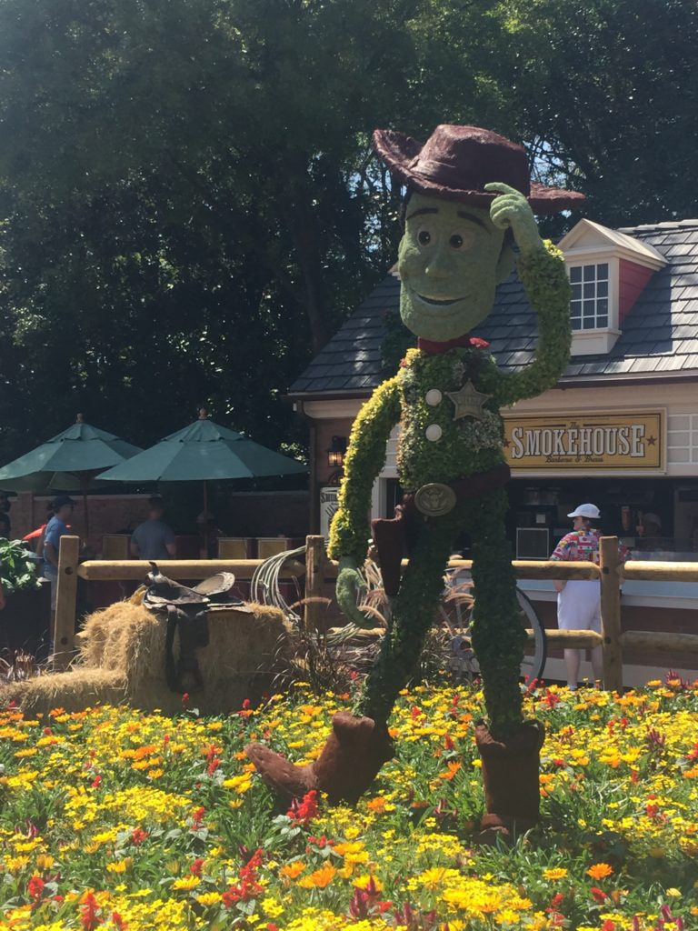 woody topiary in epcot flower and garden festival