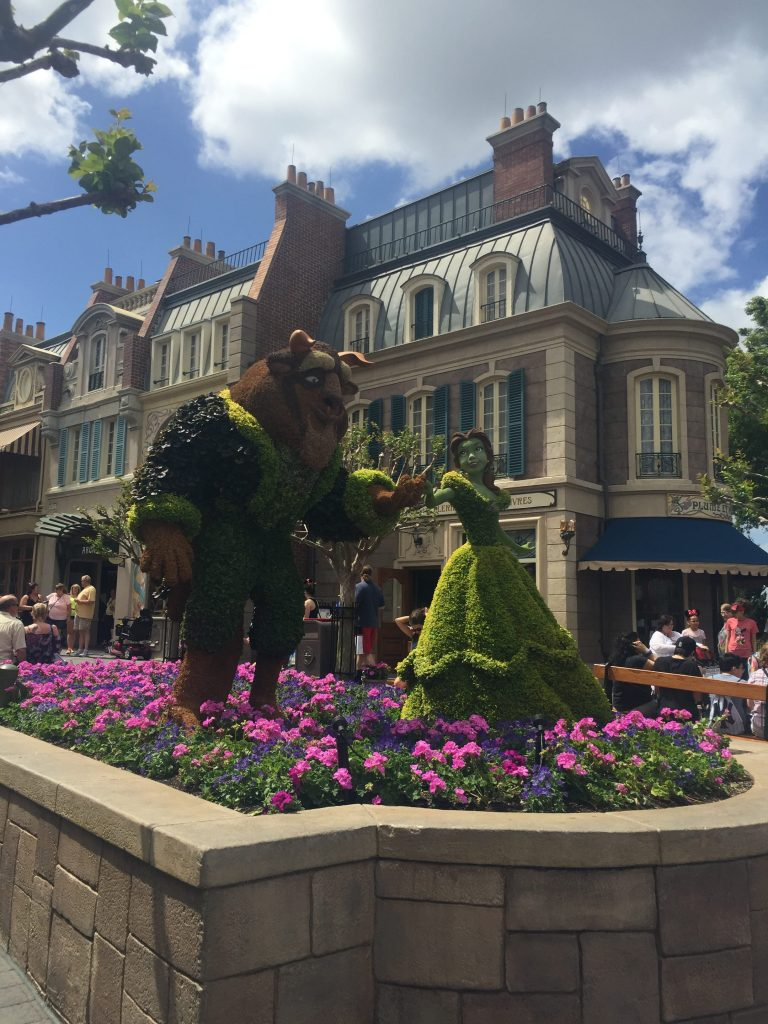 beauty and the beast topiary at epcot flower and garden
