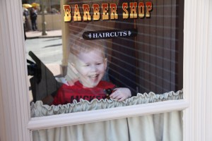 Looking out the window at Harmony Barbershop
