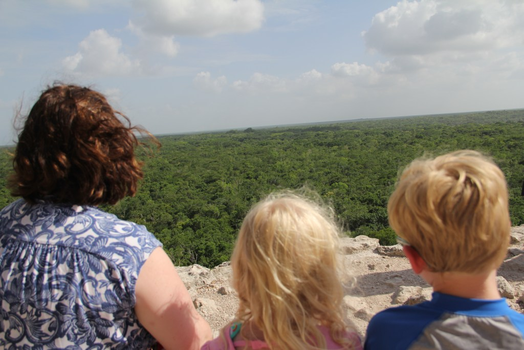 Family looking over jungle from coba