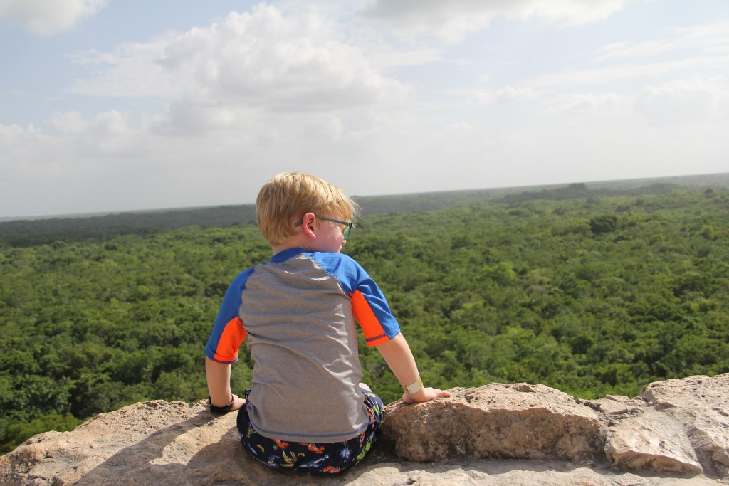 Son looking over jungle at Coba
