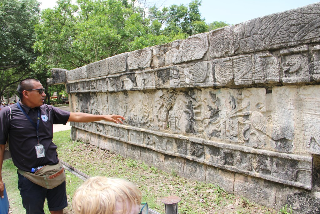Living Dreams Mexico guide explaining ruins at chicken itza