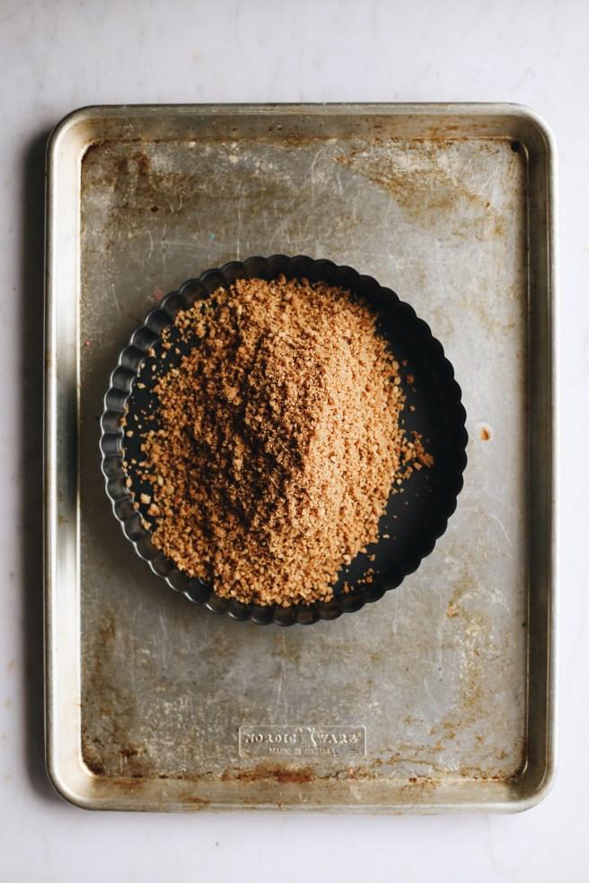 graham cracker crust poured into tart pan
