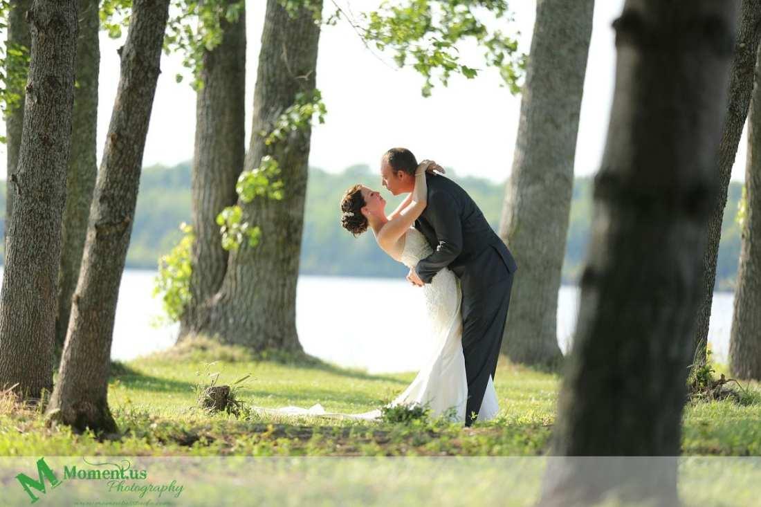 Outdoor Cornwall Wedding - groom trying to kiss bride