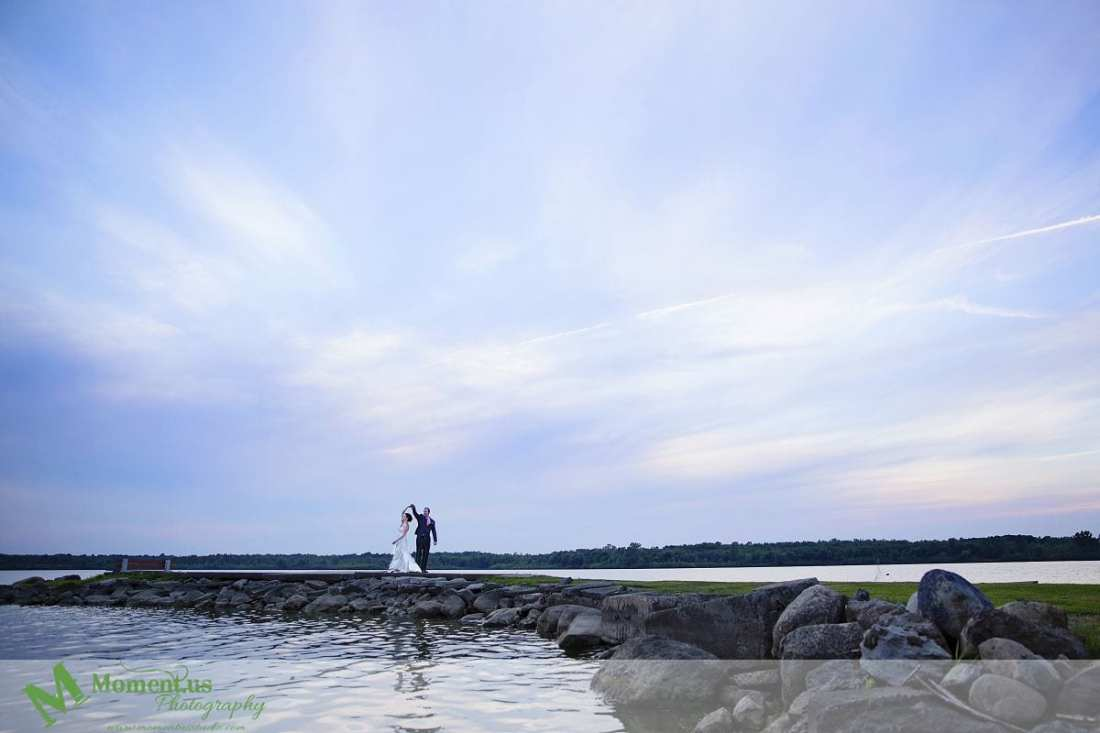 Outdoor Cornwall Wedding - bride and groom dancing by river