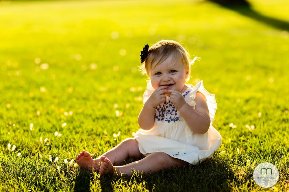 Cornwall child in blue dress on grass
