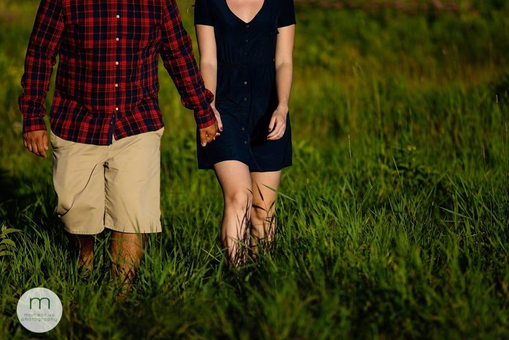 Cornwall couple walking through grass