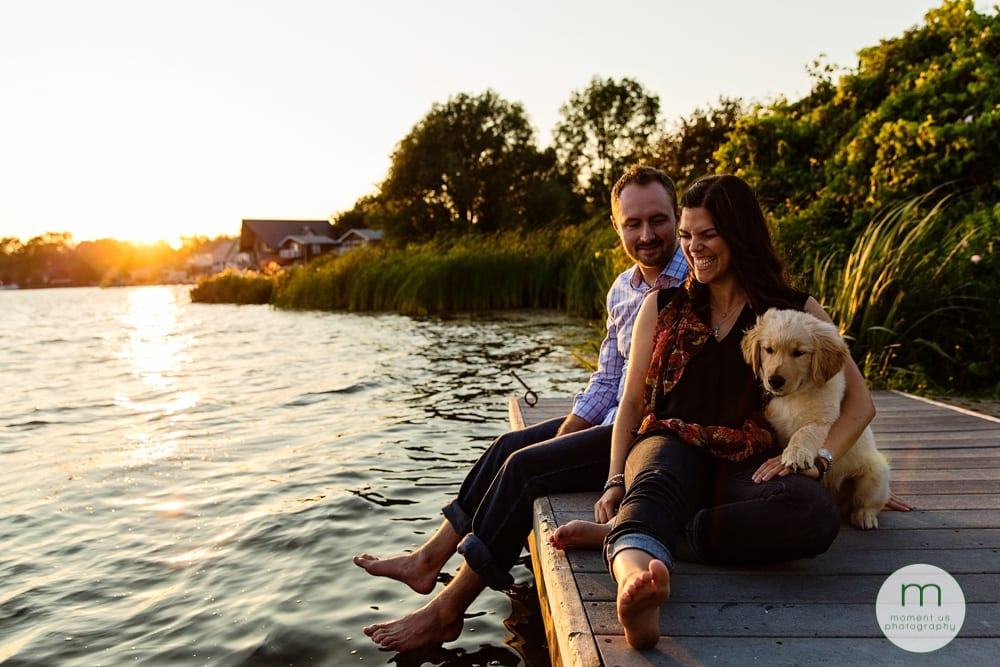 Cornwall couple sitting with dog on fock