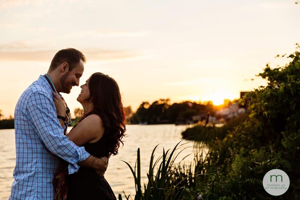 Couple cuddling in sunset