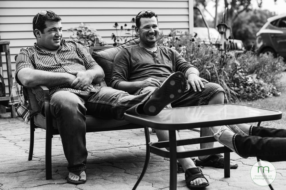 Cornwall brothers sitting together on couch