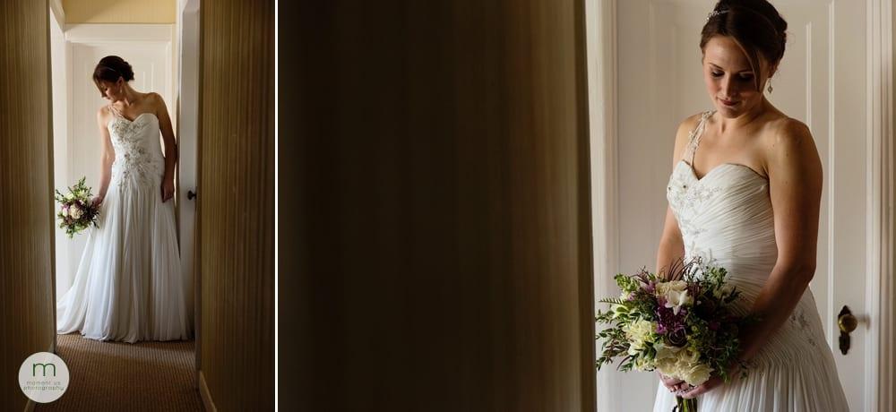 bride standing in hallway adjusting dress