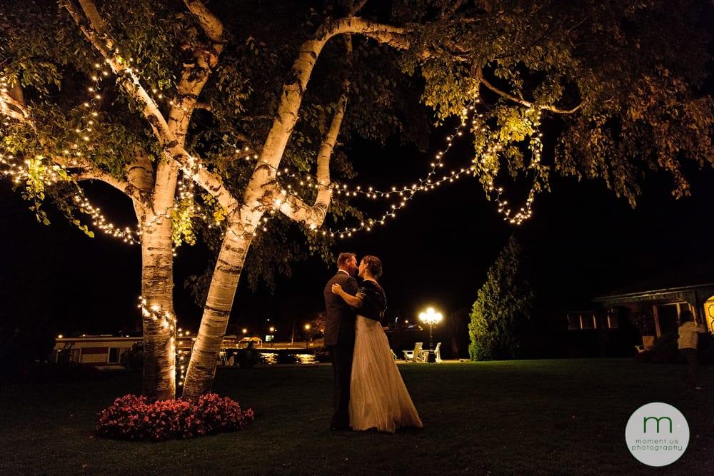 bride and groom dancing under tree