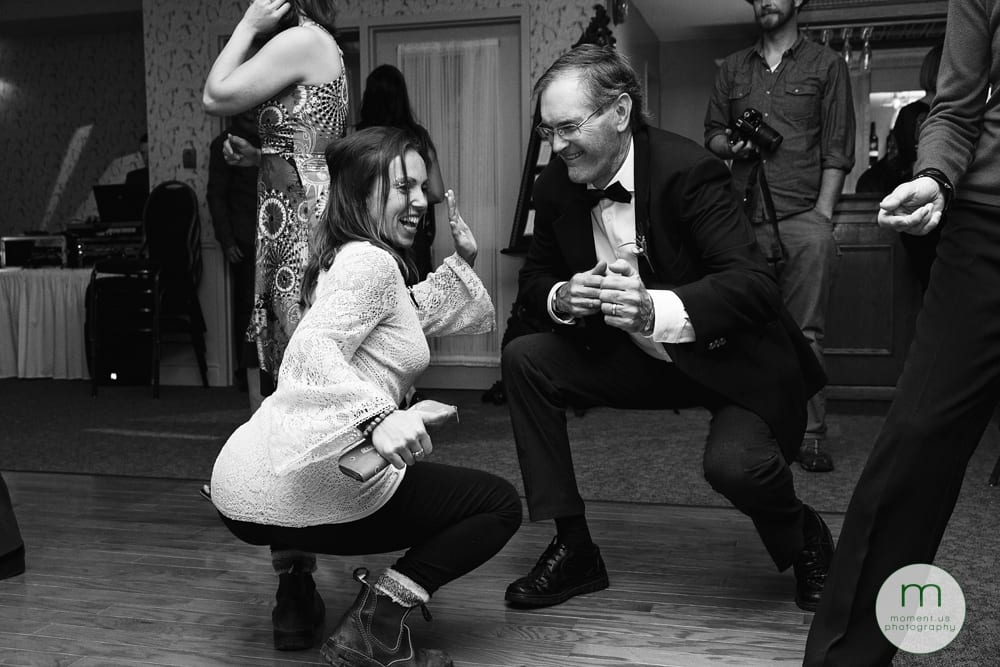woman dancing with father of the groom