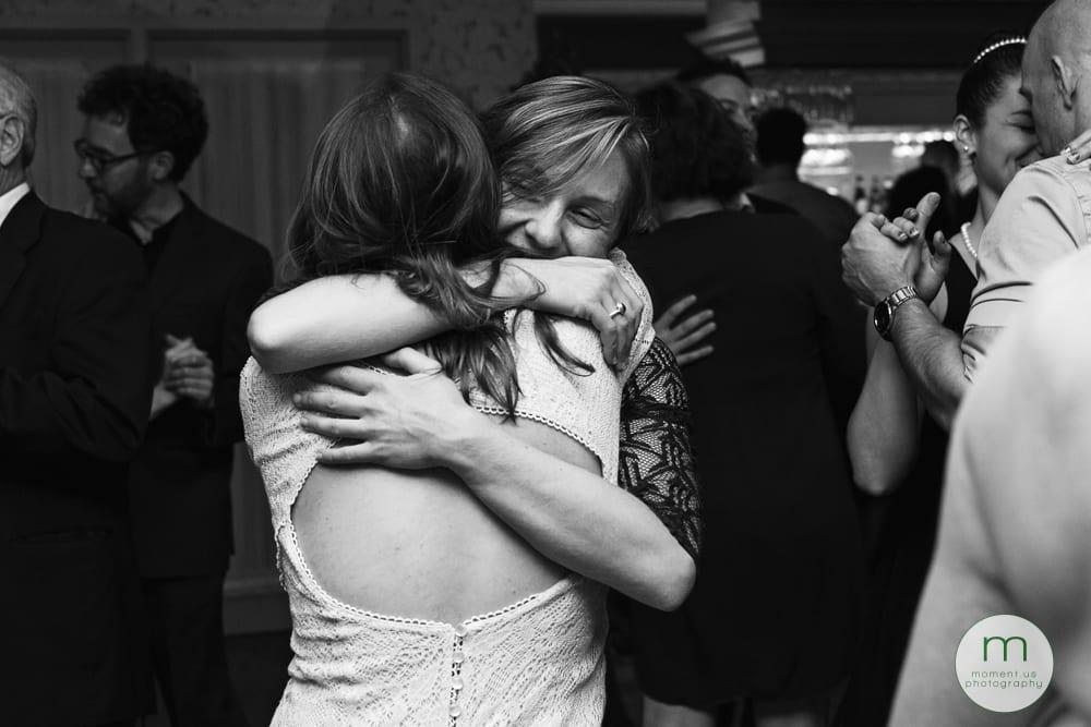 friends hugging on dancefloor