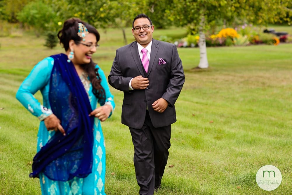 groom laughing with sister