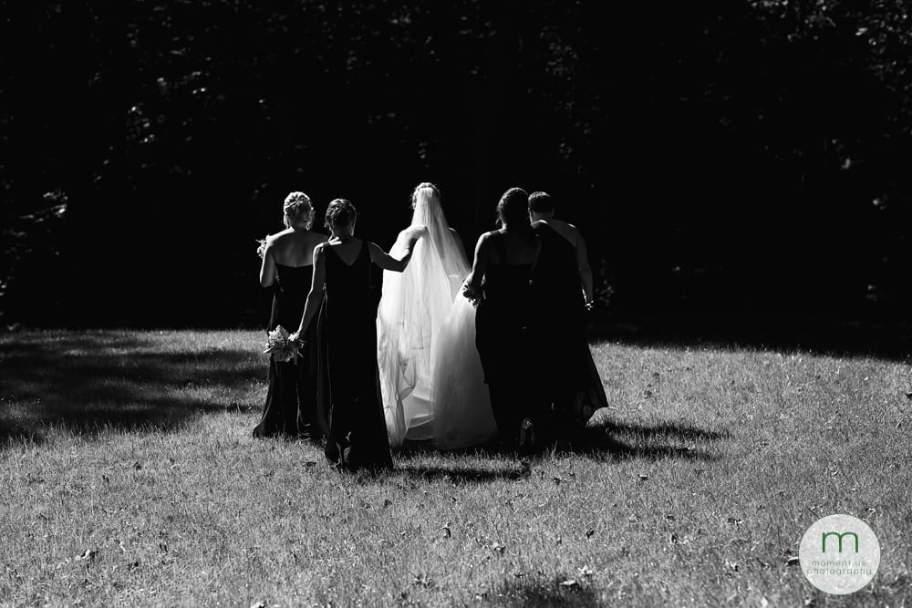 bride walking into sun with girls