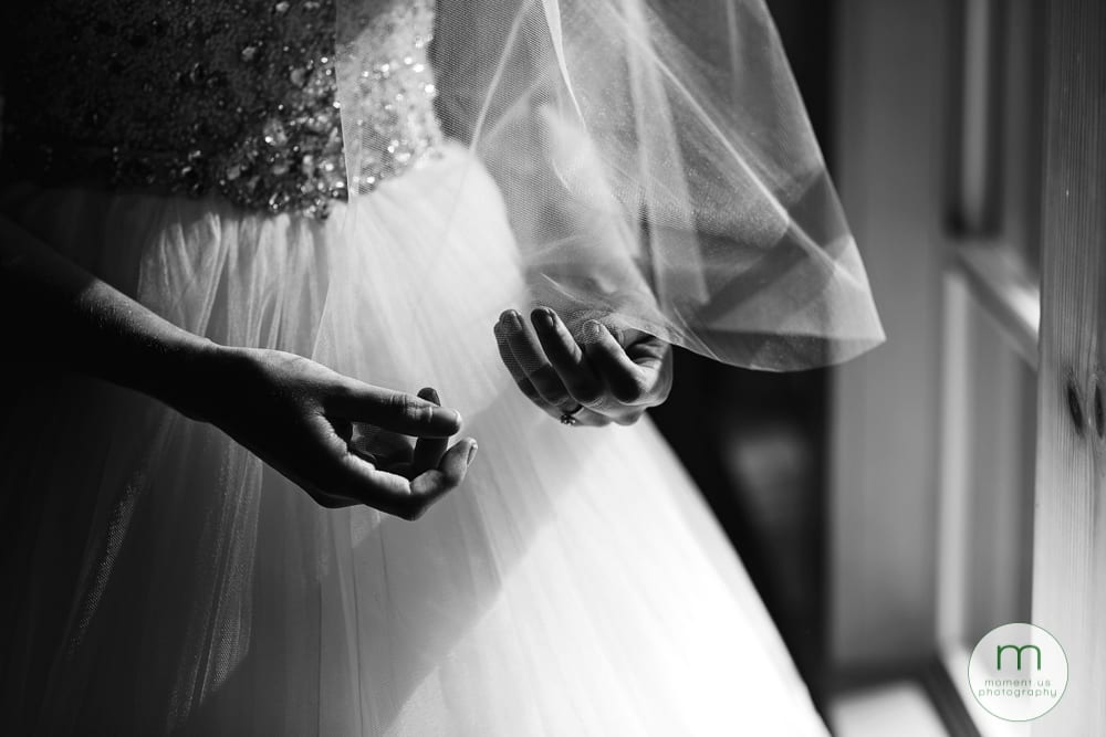 bride fiddling with veil