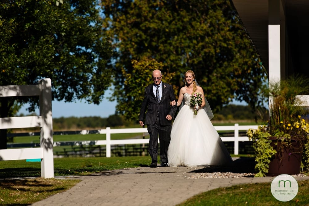 bride and father walking down aisle for Maxville Fairground wedding