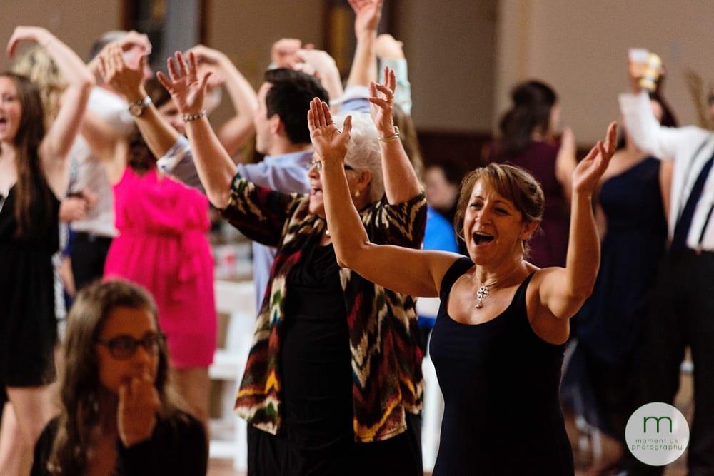 women dancing with hands in air