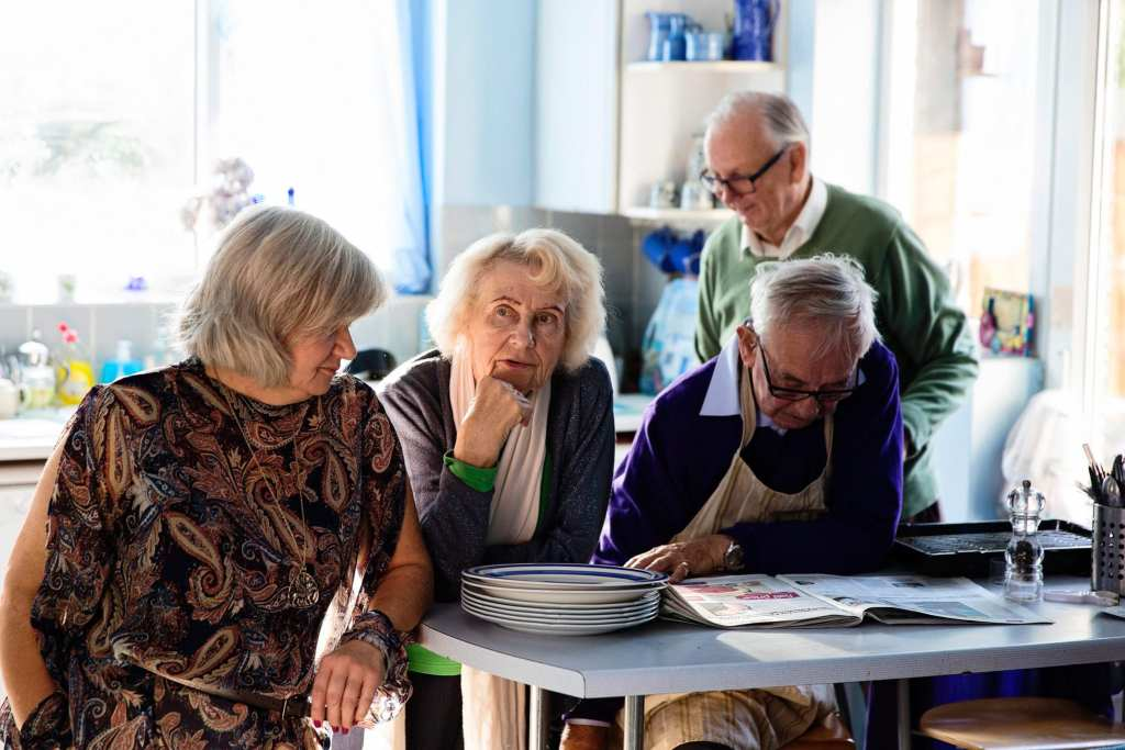 All the adults waiting in kitchen during Manchester family lunch
