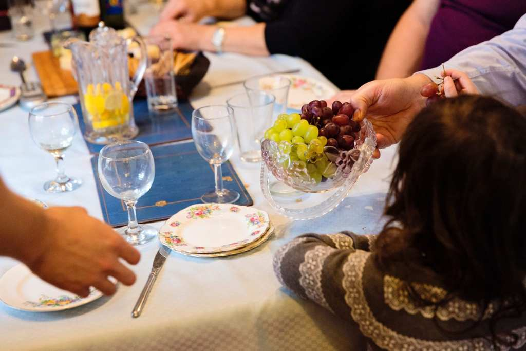 Passing grapes during Manchester family lunch