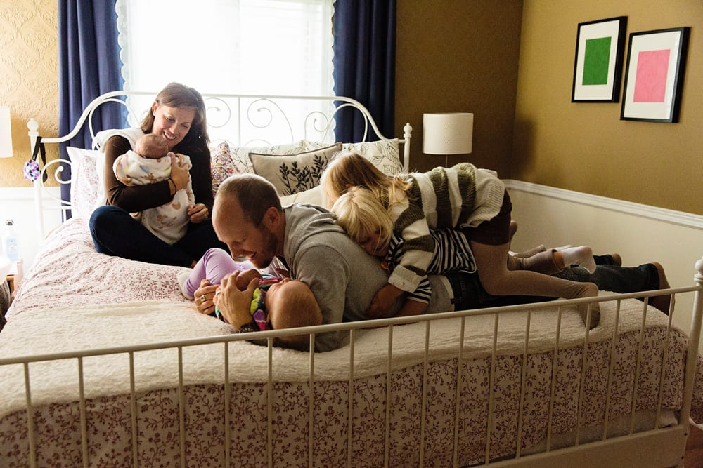 Cornwall family photographer - family piled on bed