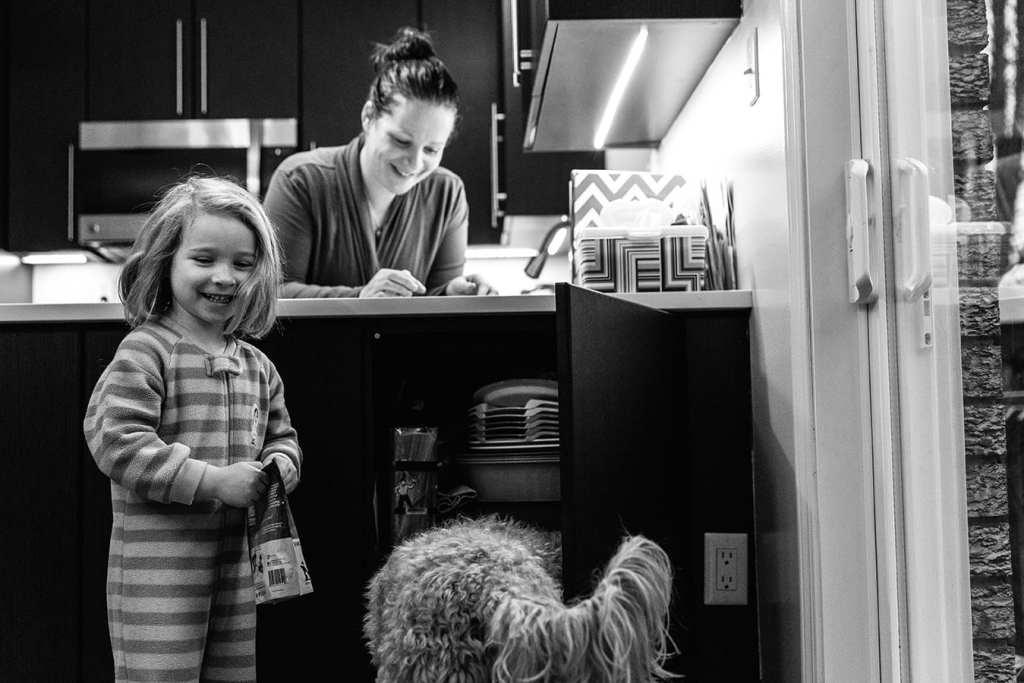 daughter feeding dog