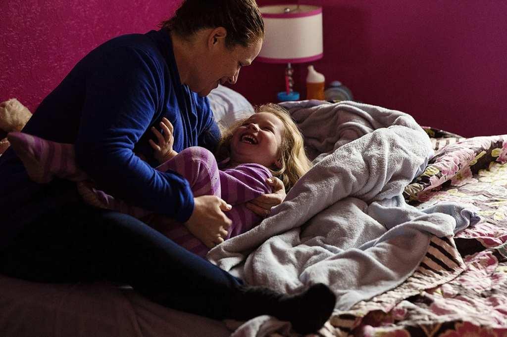 mom tickling daughter