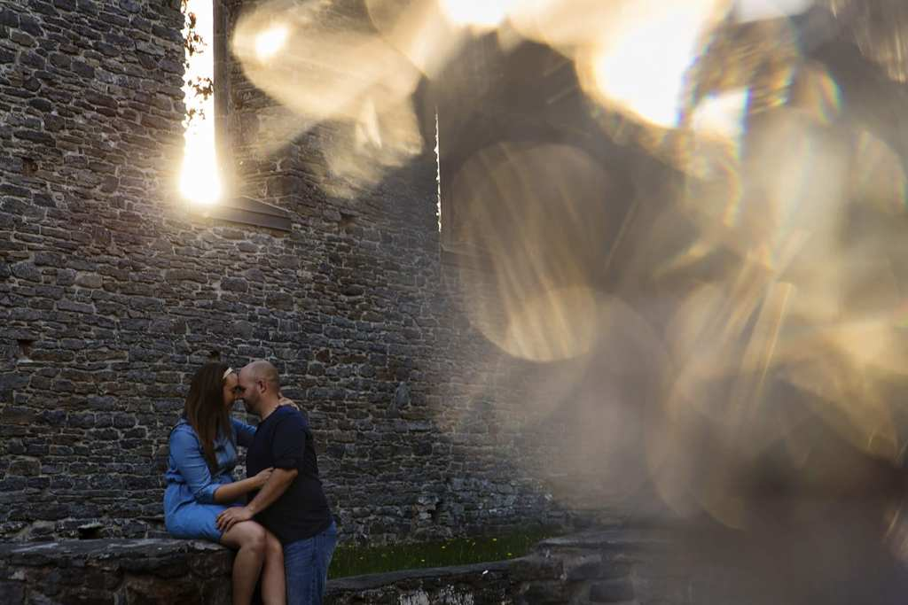 Bokeh and cuddling couple during St Raphael's engagement session