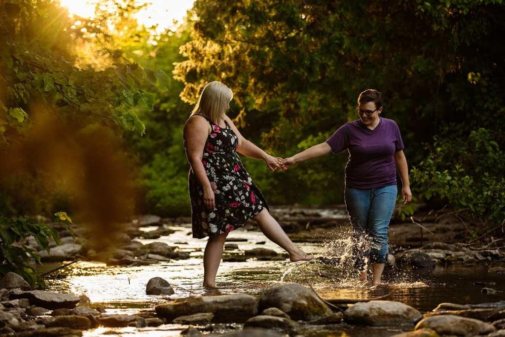 Couple splashing in eastern Ontario river