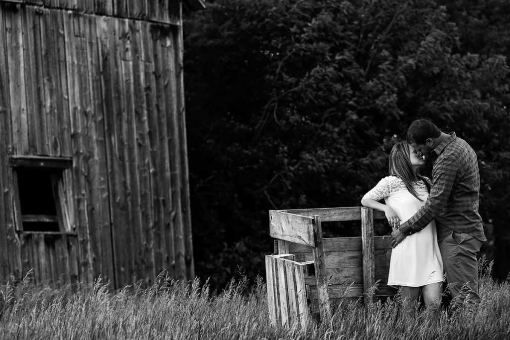 Beautiful couple kissing in Rural Cornwall engagement session