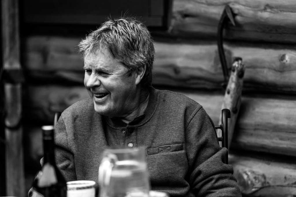 black and white shot of dad in waffle night shirt laughing and enjoying family