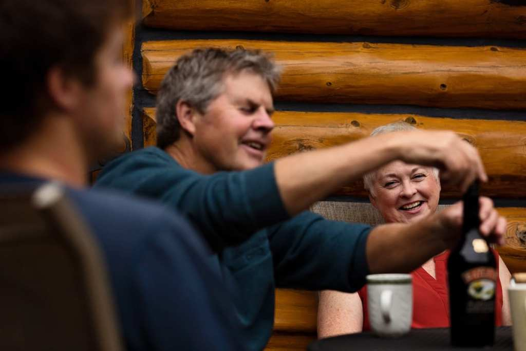 mom watching dad pour drinks in casual ontario family session