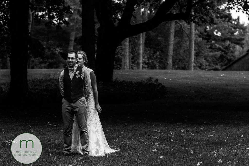 bride walks up behind groom for rural Ontario backyard wedding first look