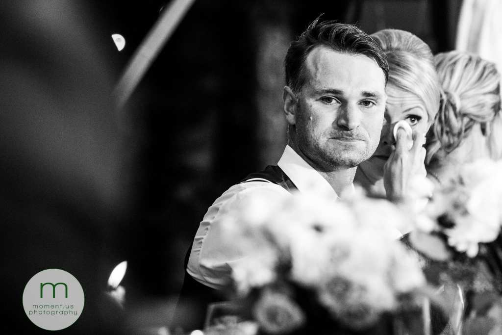 groom tries not to cry while bride wipes her eyes