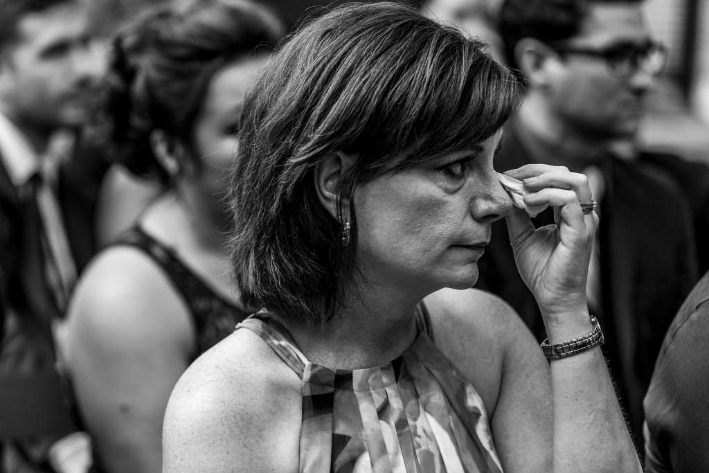 Stepmother of the groom wipes eyes during Strathmere wedding