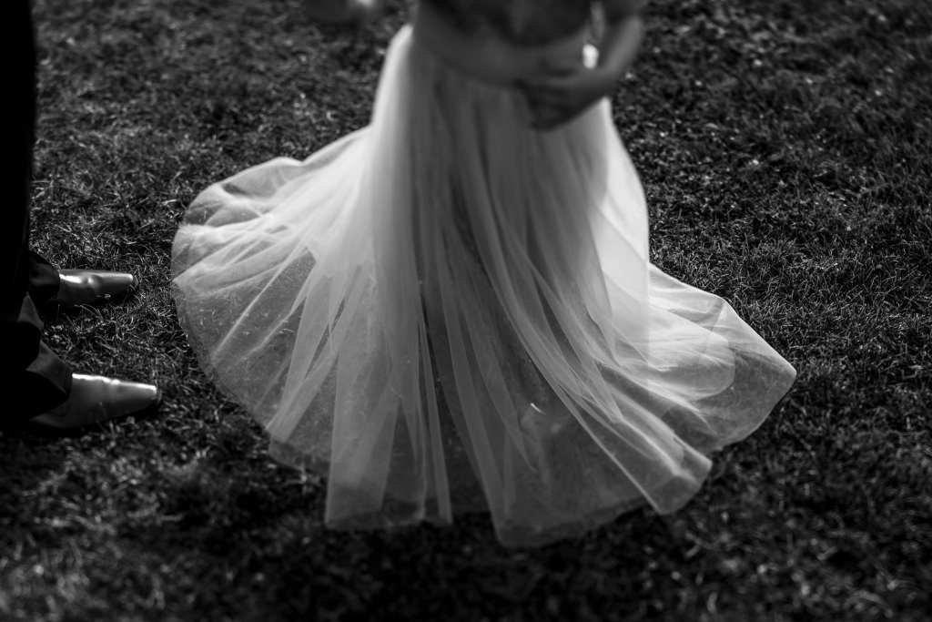young girl twirls in tulle skirt